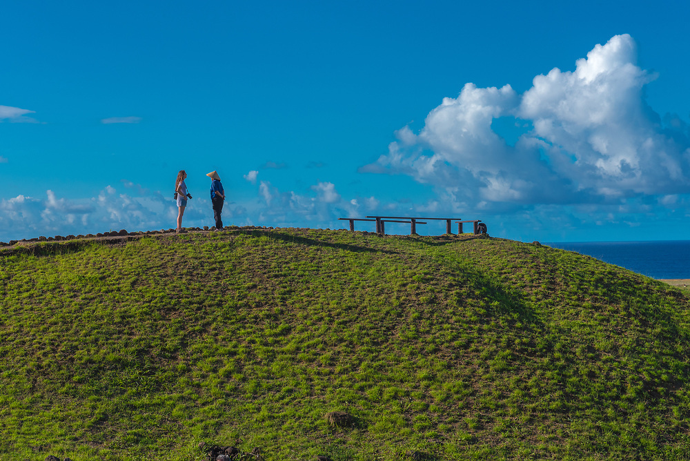 Easter Island, Chile -- March 30, 2018. Two women at the top of a hill on Easter Island. Editorial Use Only.