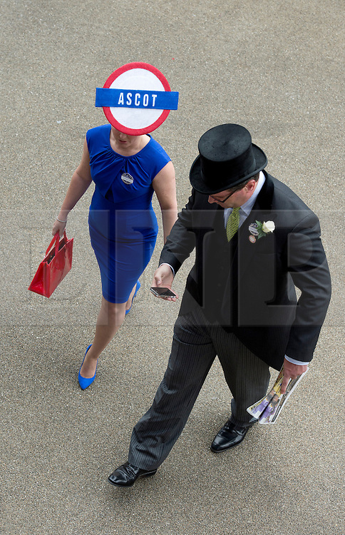 © London News Pictures. 20/06/2013. Ascot, UK.  A lady wearing an ascot hat at Ladies Day on day three of Royal Ascot at Ascot racecourse in Berkshire, on June 20, 2013.  The 5 day showcase event,  which is one of the highlights of the racing calendar, has been held at the famous Berkshire course since 1711 and tradition is a hallmark of the meeting. Top hats and tails remain compulsory in parts of the course. Photo credit should read: Ben Cawthra/LNP
