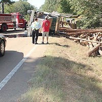 (Floyd Ingram / Buy at photos.chickasawjournal.com)<br /> An eastbound log truck tipped its load Thursday afternoon Oct. 27, 2016 on Highway 32 at the Chickasaw County line. Traffic in the area was blocked for more than hour, but no one was seriously hurt in the one vehicle accident