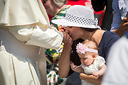 May 31, 2017: A woman kisses Pope Francis' hand. Antoine Mekary   Aleteia   I.Media
