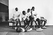 Boys rest during a fencing session at a studio in the city of Thiès, Senegal on May 2, 2015. Supported by OSIWA, organisation 'Pour un sourire d'enfant'  has implemented the sport of fencing as a form of restorative justice in a minor's prison for males and females in the city of Thiès, Senegal. This innovative judicial method works as a restorative rather than punitive approach to justice. Fencing is an effective method for helping incarcerated young people build self-confidence and respect (both for themselves and others), and engender discipline and determination.