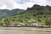French Polynesia, Nuku Hiva shoreline and lighthouse