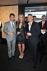 Left to right, NICK CANDY, HOLLY VALANCE and GARY LINEKER at the launch of One Hyde Park, The Residences at Mandarin Oriental, Knightsbridge, London on 19th January 2011.