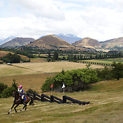 Sacha Holm-Smith riding Willow in action at the water jump during the Cross Country event at the Wakatipu One Day Horse Trials at the Pony Club grounds,  Queenstown, Otago, New Zealand. 15th January 2012. Photo Tim Clayton