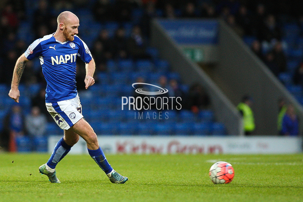 Chesterfield FC defender Chris Herd places a pass during the The FA Cup match between Chesterfield and Walsall at the Proact stadium, Chesterfield, England on 5 December 2015. Photo by Aaron Lupton.