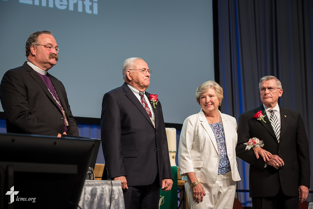 """LCMS President Rev. Dr. Matthew C. Harrison leads the convention's greeting and grateful acknowledgement of """"presidents emeriti"""" attending the convention on Wednesday, July 13, 2016, in Milwaukee. To Harrison's left are the Rev. Dr. Robert T. Kuhn, Terry Kieschnick and the Rev. Dr. Gerald B. Kieschnick. LCMS/Michael Schuermann"""