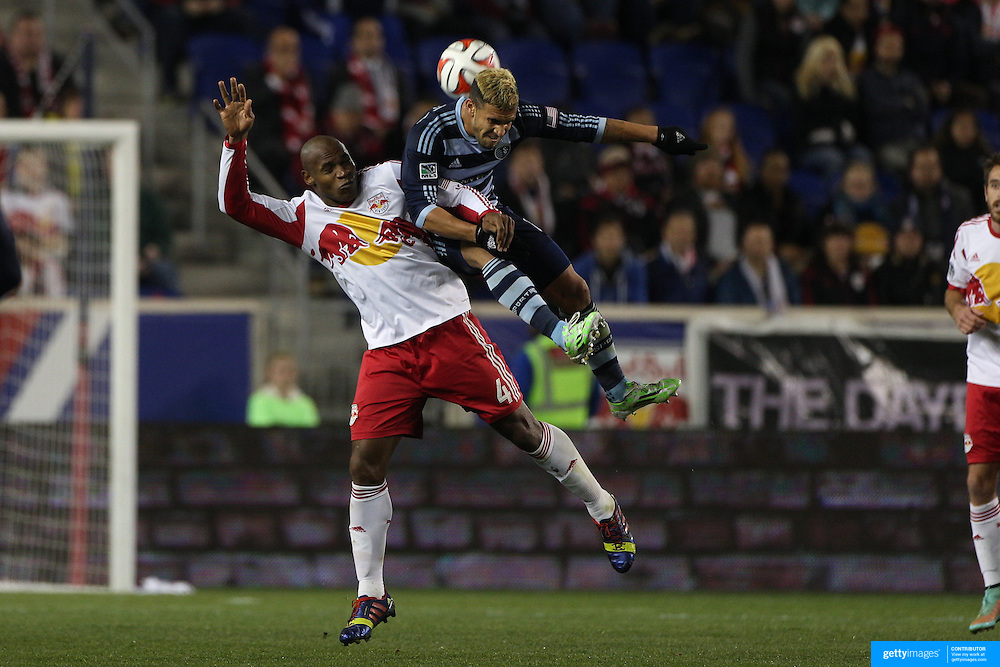 Jamison Olave, (left), New York Red Bulls and Dom Dwyer, Sporting Kansas City, challenge for the ball during the New York Red Bulls V Sporting Kansas City, Major League Soccer Play Off Match at Red Bull Arena, Harrison, New Jersey. USA. 30th October 2014. Photo Tim Clayton