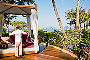 Public pool lounge bed with views of Phangna Bay.