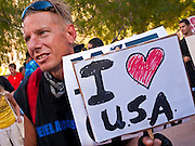16 OCTOBER 2011 - PHOENIX, AZ: An Occupy Phoenix protester in downtown Phoenix, AZ, Sunday evening. About 200 people continued the Occupy Phoenix protest in downtown Phoenix Sunday afternoon. The protest peaked Saturday afternoon at about 2,000 people. Nearly 50 people were arrested late Saturday night on misdemeanor trespassing charges when they tried to camp in a park near downtown and on Sunday the crowd dwindled to 200. Protesters hope to continue the protest through Monday by marching around downtown and picketing banks in the area.   PHOTO BY JACK KURTZ
