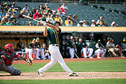 Oakland Athletics first baseman Matt Olson (28) bats against the Los Angeles Angels at Oakland Coliseum in Oakland, California, on September 6, 2017. (Stan Olszewski/Special to S.F. Examiner)