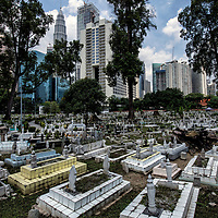 An overcrowded cemetery, a resting place for generations of Kampung Baru villagers since 1900s near the iconic Petronas Towers at Jalan Ampang near Kampung Baru, Kuala Lumpur, Malaysia, 19 April 2017.