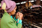 Kachin refugee housewives ai Je Yang Hka near China Myanmar boarder Lai Za, knitting a hat for her grandson.