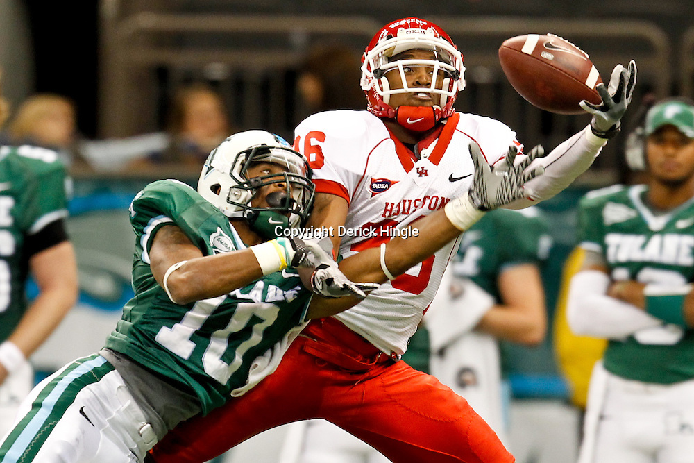 November 10, 2011; New Orleans, LA, USA; Houston Cougars wide receiver Gino Collins (36) catches a pass overTulane Green Wave cornerback Ryan Travis (10) during the second half at the Mercedes-Benz Superdome.  Houston defeated Tulane 73-17. Mandatory Credit: Derick E. Hingle-US PRESSWIRE