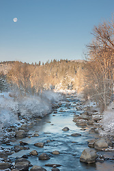 """Snowy Truckee River 5"" - Photograph of a moon setting over a snowy Truckee River in Downtown Truckee, California."
