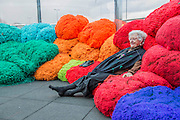 Sheila Hicks: Foray into Chromatic Zones - The first art installation presented within the Dan Graham Waterloo Sunset Pavilion overlooking Waterloo Bridge and the London Skyline. It includes: scale bundles of coloured fabric that visitors are welcome to sit on and interact with; and mounds of differently and vibrantly coloured fabric that hang from the ceiling. Hayward Gallery Project Space, Southbank, London UK 23 Feb 2015.
