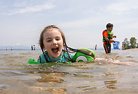 Leila Kulacz of Concord takes a swim in Lake Winnipesaukee at Ellacoya State Park Beach on Friday.  (Karen Bobotas/for the Laconia Daily Sun)