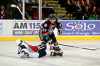 KELOWNA, CANADA, OCTOBER 5: Jessey Astles #27 of the Kelowna Rockets checks Sam Grist of the Tri City Americans during first period play on October 5, 2011 at Prospera Place in Kelowna, British Columbia, Canada (Photo by Marissa Baecker/shootthebreeze.ca) *** Local Caption *** Jessey Astles;Sam Grist;