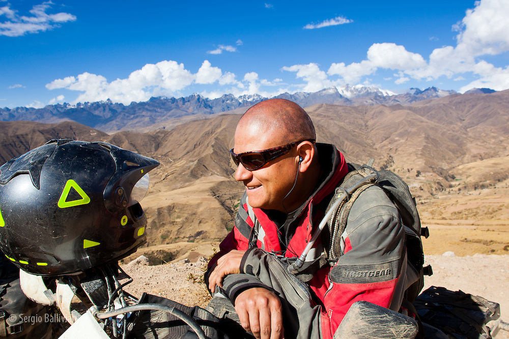 Oscar Ebert enjoys the motorcycle route and sunshine in the Cordillera Quimsa Cruz, Bolivia.