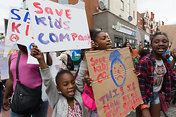 © Licensed to London News Pictures.05/08/2015. London, UK. Protesters demonstrate outside the Kids Company Centre in Kenbury Street, south east London today about the closure of the youth charity, the Kids Company led by Camila Batmanghelidjh. The Kids Company has been hit by financial impropriety and sex abuse claims. Photo credit : Vickie Flores/LNP