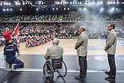 UNITED KINGDOM, London: 2015 World Wheelchair Rugby Challenge. Caption: The Canadian coaching staff pause for the Canadian National Anthem before the World Wheelchair Rugby Championship Finals between the USA and Canada. Rick Findler / Story Picture Agency