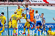 AFC Wimbledon goalkeeper George Long (1), on loan from Sheffield United, takes the ball off the head of Wigan Athletic defender Dan Burn (33) from a corner during the EFL Sky Bet League 1 match between Wigan Athletic and AFC Wimbledon at the DW Stadium, Wigan, England on 28 April 2018. Picture by Simon Davies.