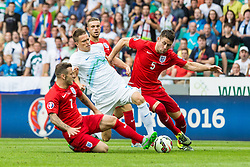 Josip Ilicic of Slovenia and Jack Wilshere & Gary Cahill of England during the EURO 2016 Qualifier Group E match between Slovenia and England at SRC Stozice on June 14, 2015 in Ljubljana, Slovenia. Photo by Grega Valancic