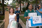 17072Student Move in Day 9/1/05: President McDavis, Mrs. McDavis,and Terry Hogan Greeting Students