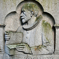 Pastor Emil Koch Relief in Odense, Denmark <br /> This moss-covered relief near the Greyfriars Abbey is a tribute to Emil Koch.  He was an influential pastor at the Sankt Knuds Kirke, better known as the Odense Cathedral, and the Franciscan hospital church.  He was also a prominent social leader during the early 20th century plus the chairman of the Odense college association.