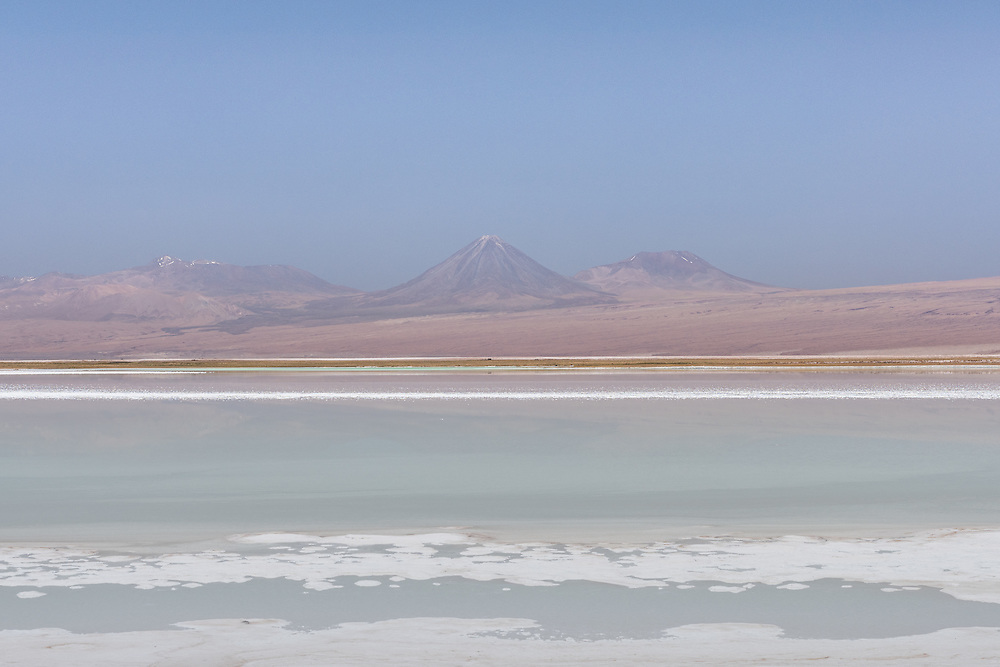 The salty waters of Tebinquinche with on the background volcano Licancabur and the Andes mountain range, Tebinquinche, Chile.