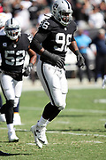 Oakland Raiders defensive end Denico Autry (96) celebrates as he jumps in the air after tipping a first quarter pass on a third down play during the 2017 NFL week 6 regular season football game against the against the Los Angeles Chargers, Sunday, Oct. 15, 2017 in Oakland, Calif. The Chargers won the game 17-16. (©Paul Anthony Spinelli)