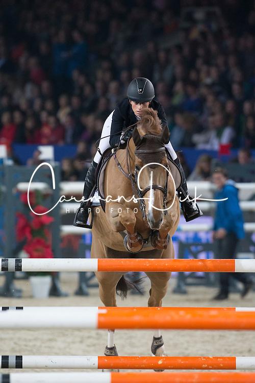 Sprunger Janika (SUI) - Electra van't Roosakker<br /> Prijs KBC Bank &amp; Verzekeringen<br /> Flanders Christmas Jumping - Mechelen 2012<br /> &copy; Dirk Caremans
