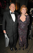 01.DECEMBER.2009 - LONDON<br /> <br /> CILLA BLACK AND JOHN MADEJSKI LEAVING THE MORGAN'S AWARD'S 2009 HOSTED BY PIERS MORGAN AT THE MANDARIN ORIENTAL HOTEL IN KNIGHTSBRIDGE LONDON<br /> <br /> BYLINE: EDBIMAGEARCHIVE.COM<br /> <br /> *THIS IMAGE IS STRICTLY FOR UK NEWSPAPERS & MAGAZINES ONLY*<br /> *FOR WORLDWIDE SALES & WEB USE PLEASE CONTACT EDBIMAGEARCHIVE-0208 954 5968*