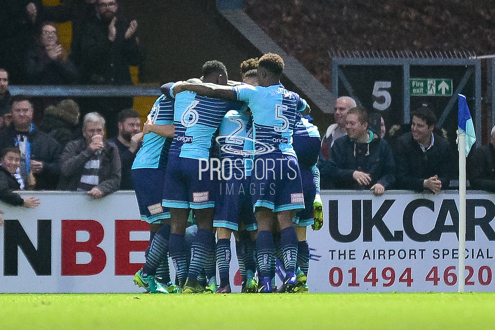 The Wycombe Wanderers players  celebrate Wycombe Wanderers midfielder Sam Wood (11) goal during the The FA Cup match between Wycombe Wanderers and Stourbridge at Adams Park, High Wycombe, England on 7 January 2017. Photo by Dennis Goodwin.
