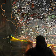 March 1, 2009. Miami Beach, FL. A Starbucks employee performs the weekly task of erasing the wall-sized mural of messages written in chalk by customers of the coffeehouse located at 605 Lincoln Road in South Beach.