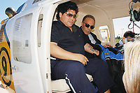 17/09/04 - DIEGO MARADONA GAVE AN INTERVIEW IN AN HELICOPTER - Buenos Aires - Argentina.<br />He gave his last interview to an important channel of Argentina before his trip to Cuba where he will continue his medical treatment for drugs.<br />Here with his personal dr. CAHE.<br />©Argenpress.com