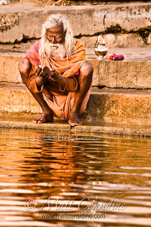 The water of the Ganges is considered sacred and is believed by the devout to be a god.<br /> (Photo by Matt Considine - Images of Asia Collection)