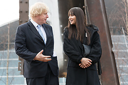 © Licensed to London News Pictures. 17/03/2015. London, UK. Mayor of London, Boris Johnson with artist, Miya Ando at a special ceremony to unveil her steel sculpture crafted out of the 9/11 Twin Towers' steel wreckage at the Queen Elizabeth Olympic Park in Stratford today. The artwork by American artist, Miya Ando commemorates the 10th anniversary of the 9/11 attacks and stands at 28 feet tall and weighs over 4 tons. Photo credit : Vickie Flores/LNP