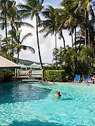 Relaxing in the pool at Daydream Island Resort; Whitsunday Islands, QLD, Australia.