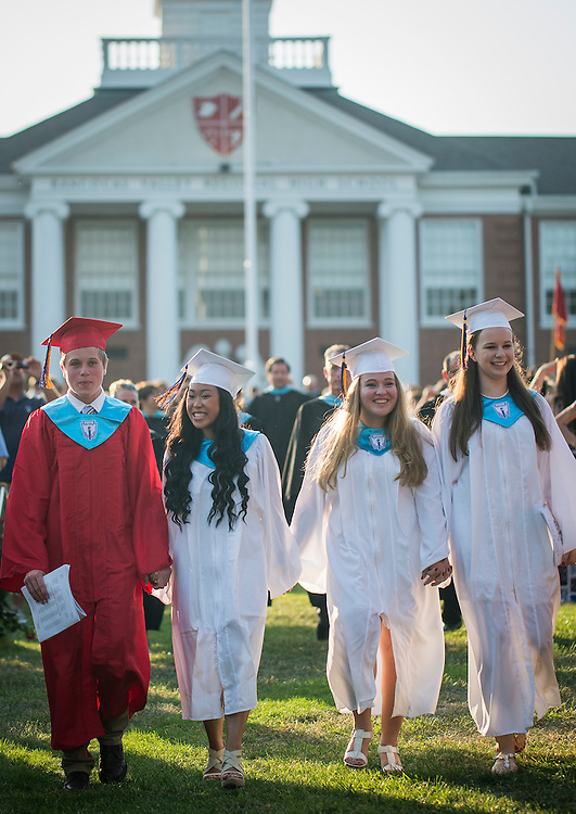 Class President Kilian Teschko, Student Council President Rachel Yee, Valedictorian Casey McBride, and Salutatorian Jaclyn Taylor, process down to the stage during graduation exercises at Rancocas Valley Regional High School in Mt. Holly, NJ, Wednesday, June 18, 2014  (PHOTO Bryan Woolston / @woolstonphoto)