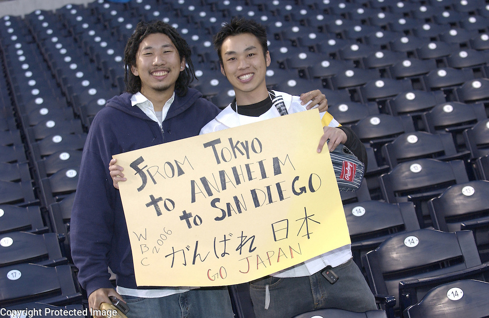 Andy Chen (L) and Richard Hwang (R) from Los Angeles, CA show their support for Team Japan at PETCO Park, San Diego, CA.