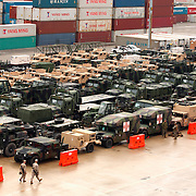 Military vehicles and supplies are prepared to be shipped from the North Carolina State Port of Wilmington to various deployments in the Middle East. Most of this shipment is from Camp Lejeune, the largest Marine Corps Base on the East Coast of the United States, also located in North Carolina.