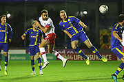 Clark Robertson heads at goal during the The FA Cup match between Solihull Moors and Rotherham United at the Automated Technology Group Stadium, Solihull, United Kingdom on 2 December 2019.
