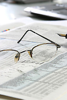 Glasses on a newspapper