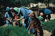 SPAIN / Castile-La Mancha / Toledo province / Consuegra.  Medieval recreations in Spain. Every August the village recreates a battle of 1097 between the Castilian and Leonese army of Alfonso VI and the Almoravids. Women and children in the gardens of the castle.....