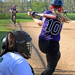 Staff photos by Tom Kelly IV<br /> Upper Darby's A. Turchi (10) hits a line drive foul ball right at her teammate S. Witmer (11) who caught the ball during the Ridley at Upper Darby softball game on Wednesday.