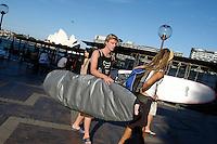 Man with surfboard, Circular quay, Sydney, Australia. January 2nd-11th 2007