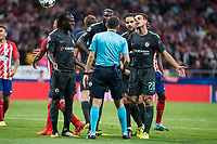 Chelsea's Victor Moses, Cesc Fabregas and Cesar Azpilicueta protesting to the referee during UEFA Champions League match between Atletico de Madrid and Chelsea at Wanda Metropolitano in Madrid, Spain September 27, 2017. (ALTERPHOTOS/Borja B.Hojas)