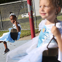 Lauren Wood | Buy at photos.djournal.com<br /> Carleigh Hardin, 3, left, and Lennox Coon, 3, both dressed as Cinderella, swing together on the swing set Tuesday morning at the NMMC Child Care Center.