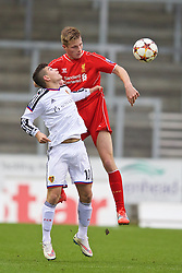 LIVERPOOL, ENGLAND - Tuesday, December 9, 2014: Liverpool's Daniel Cleary in action against FC Basel's Arxhend Cani during the UEFA Youth League Group B match at Langtree Park. (Pic by David Rawcliffe/Propaganda)