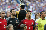 Portugal Forward Cristiano Ronaldo sings the national anthem during the Euro 2016 final between Portugal and France at Stade de France, Saint-Denis, Paris, France on 10 July 2016. Photo by Phil Duncan.